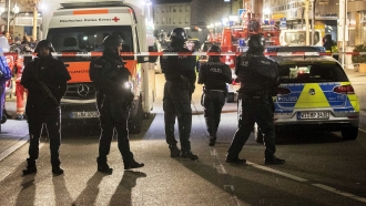 Authorities investigate the scene of a shooting in Hanau, Germany