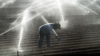 A California farmer irrigates his field