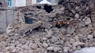 Houses are reduced to rubble after an earthquake hit villages in Baskale in Van province, Turkey, at the border with Iran