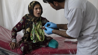 Girl receives medical care in Kabul