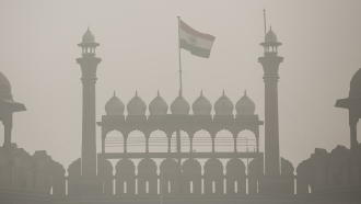 A file image of the Indian flag obscured by smog