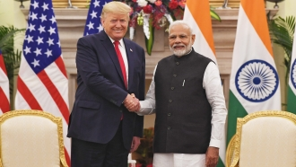 President Donald Trump and Indian Prime Minister Narendra Modi shake hands
