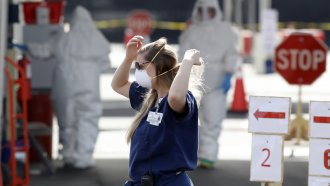 A health care worker wearing a mask