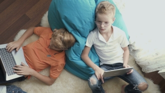 Kids use laptops and tablets