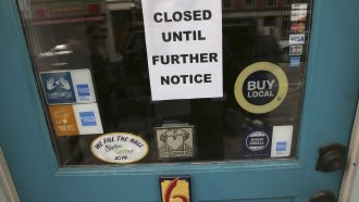 Closed sign in business' window
