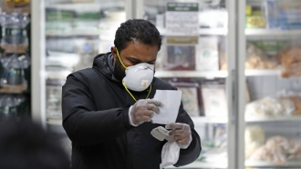 Man shops with a mask on.