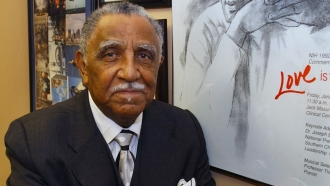 The Rev. Joseph Lowery poses with a line drawing of Martin Luther King, Jr. in his office