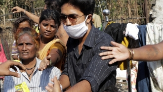 Social workers distribute aid to homeless people during coronavirus lockdown in Mumbai, India