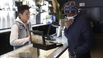 Customer wears mask in dispensary