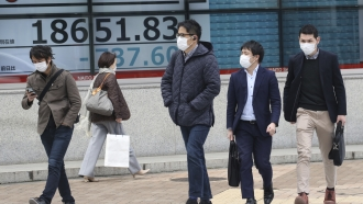 People walk by with medical masks on in Tokyo, Japan.