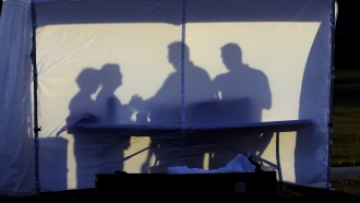 Medical personnel outside a coronavirus testing tent in Florida
