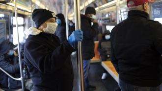Subway riders in New York wearing masks