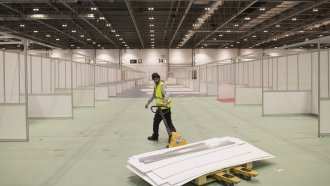 Work continues at the ExCel centre, which is being made into a temporary hospital in London.