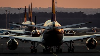 Lufthansa aircrafts are parked at the airport in Frankfurt, Germany.