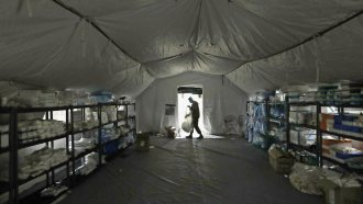 A U.S. Army soldier walks inside a mobile surgical unit.