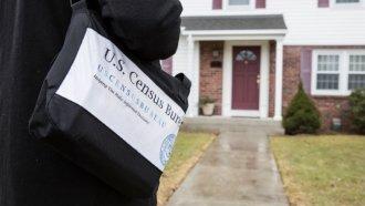 A Census Bureau employee walks up to a home