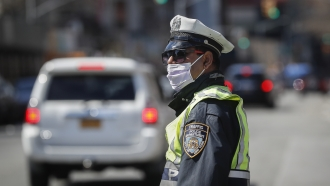 NYPD officer wearing a mask