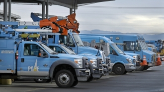 Pacific Gas & Electric vehicles are parked at the PG&E Oakland Service Center in Oakland, Calif.