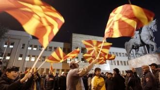People waving North Macedonian flags