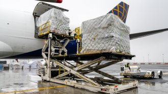 A plane unloading cargo in New York City
