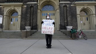 Protester calls on Wisconsin to delay primary vote