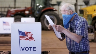 Person wears mask at polling place