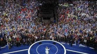 Then Democratic presidential nominee Hillary Clinton waves to delegates at the 2016 Democratic National Convention