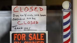 """For Sale By Owner"" and ""Closed Due to Virus"" signs"