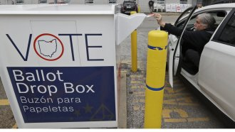 A voter drops off a ballot in Ohio