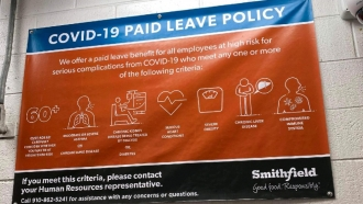 Paid leave policy sign in Smithfield plant