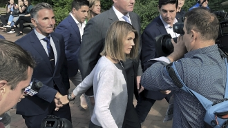 Lori Loughlin and her husband leaving court