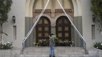 Man stands outside of church