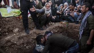 Mourners at a funeral for Syrian Democratic Forces fighter who was killed by ISIS