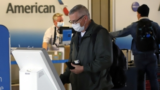 Man uses American Airlines kiosk
