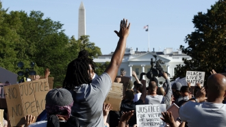 Demonstrators gather in Lafayette Park to protest the death of George Floyd, Monday, June 1, 2020, near the White House.
