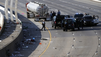 Police in the area where a tanker truck rushed to a stop among protesters on an interstate