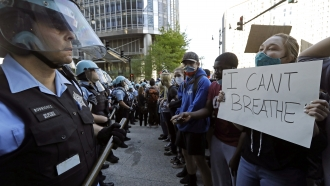 People confront police officers during a protest over the death of George Floyd in Chicago.