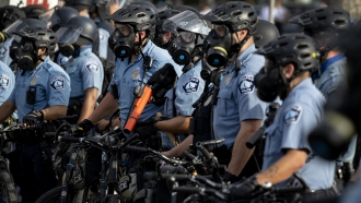 Police gather en masse as protests continue at the Minneapolis 3rd Police Precinct, Wednesday, May 27, 2020, in Minneapolis