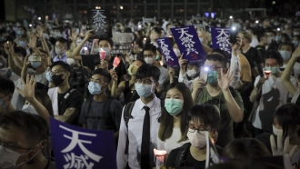 Hong Kong residents gather to commemorate the anniversary of the 1989 Tiananmen Square Massacre