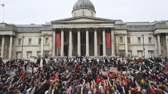 Protesters gather in London's Trafalgar Square on Wednesday, June 3, 2020, during a demonstration over the death of George Fl
