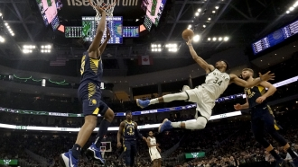 Giannis Antetokounmpo shoots after being fouled during the second half of an NBA basketball game.