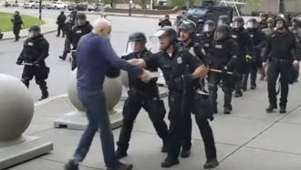 A Buffalo police officer appears to shove a man who walked up to police Thursday, June 4, 2020, in Buffalo, N.Y.
