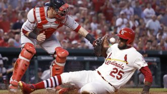 The St. Louis Cardinals' Dexter Fowler scores against the Boston Red Sox