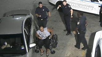 Deputies from Harris County Sheriff's Office fire taser at African American woman seated in wheelchair