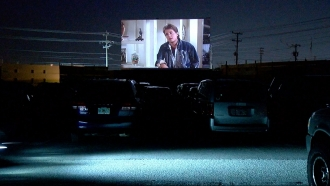 Cars at drive-in movie theater