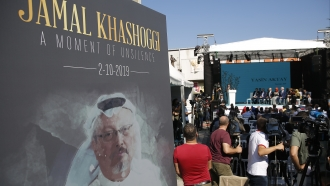 A picture of JAmal Khashoggi stands during one year anniversary memorial