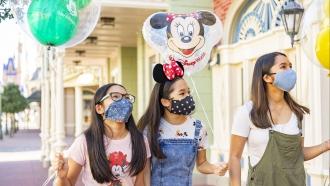 Girls walk in Walt Disney World park