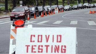 Motorists line up at a coronavirus testing site at Dodger Stadium in Los Angeles.