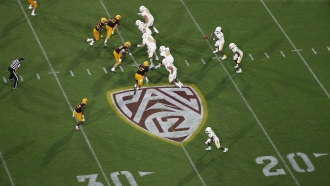 This Thursday, Aug. 29, 2019, file photo, shows the Pac-12 logo during the second half of an NCAA college football game