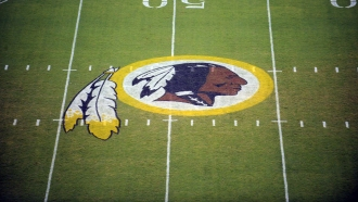 The Washington Redskins logo is shown on the field.